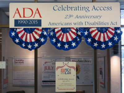 display at the Mansfield Library on the 25th anniversary of ADA passing includes photos and posters