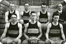 7 members of the 1915 UM basketball team. The coach is in the upper right of the photo and all members are in their uniforms.