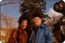 Patricia Goedicke and Leonard Wallace Robinson in front of the Grizzly statue on the UM campus.