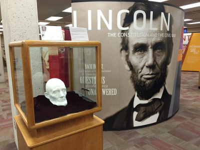 Photo of the first panel of the Lincoln exhibit as well as a display case with a 3D printed model of President Lincoln's head.