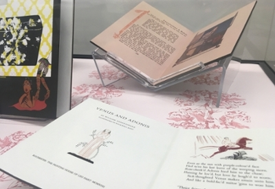 display case in Archives with three texts from Wicker Collection