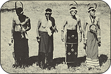 Four plains indians in traditional dress