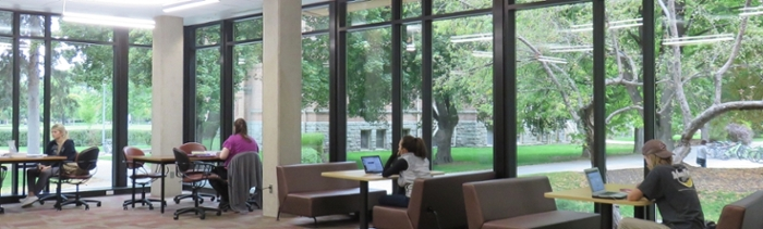students studying at learning commons in library