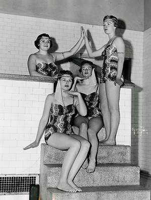 Four women posing in bathing suits