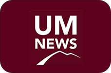um news logo with mountain